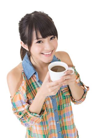 half  length: Attractive smiling asian woman with white cup of coffee or tea. Half length portrait. Isolated on the white background.