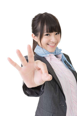 Young asian business woman showing OK sign. Closeup portrait. Isolated on the white background. photo