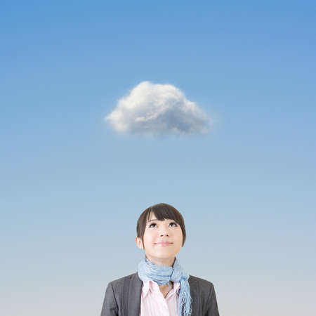 blue sky thinking: Charming asian business woman looking up on a thoughful cloud.