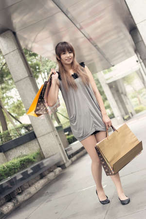 Asian modern woman shopping at street, Taipei, Taiwan, Asia. photo