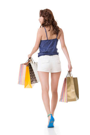 woman back view: Attractive asian woman shopping and holding bags. Full length portrait. Rear view. Isolated on the white background.