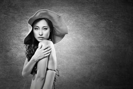 asian bikini: Attractive sexy asian lady in bikini with hat. Black and white photo. Stock Photo