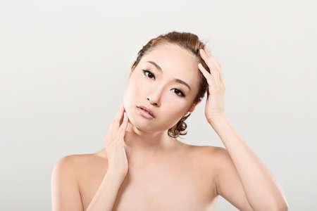 Asian beauty face closeup portrait with clean and fresh elegant lady. Studio shot. photo