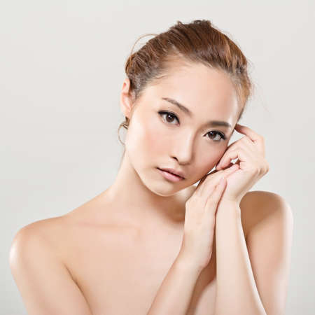 Asian beauty face closeup portrait with clean and fresh elegant lady. Studio shot. photo