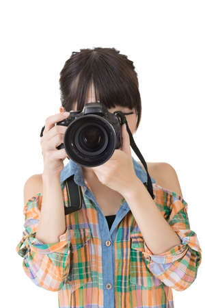 half  length: Young asian woman takes pictures with photo camera. Half length portrait. Isolated on the white background.