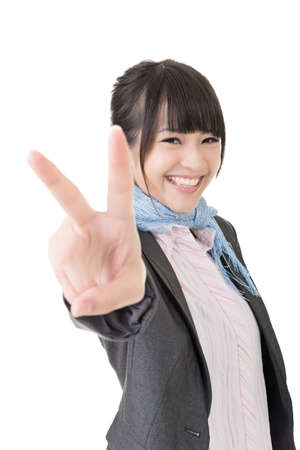 korean woman: Asian business woman showing a gesture of peace. Closeup portrait. Isolated on the white background. Stock Photo