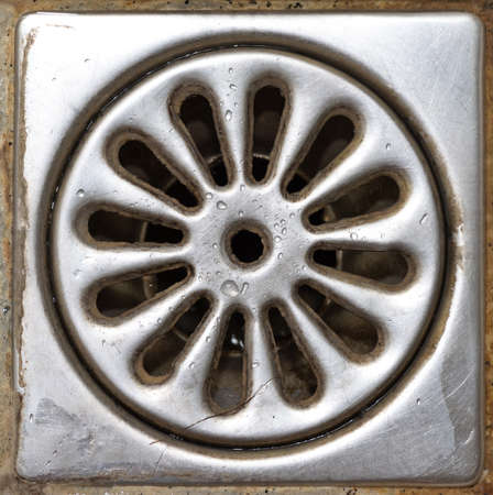 Old dirty shower drain close-up photo