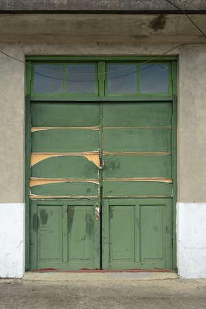 Old green grunged door. photo