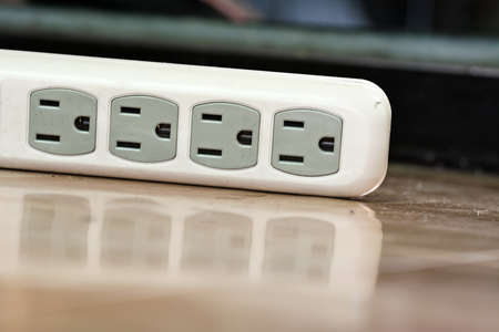 White power strip or extension block laying on the floor. Stock Photo - 22558407