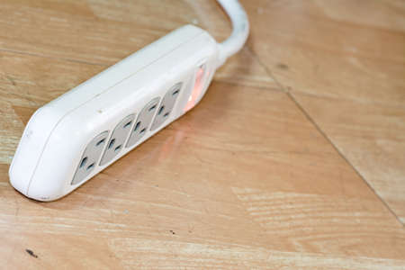 White power strip or extension block laying on the floor. Stock Photo - 22558409