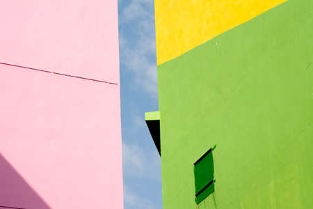 violet residential: Colorful house iin abstract under blue sky Stock Photo