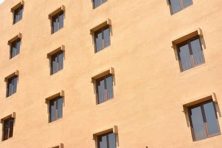 Windows of house under blue sky. photo