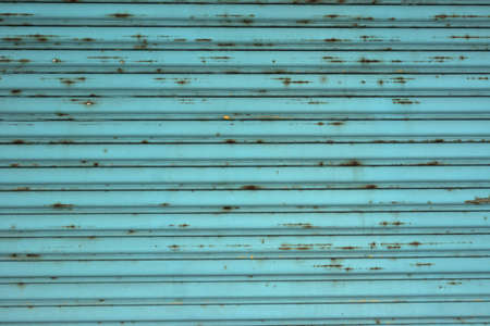 Background of metal turquoise wall in grungy style. photo