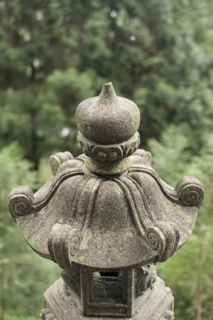 Traditional asian stone lantern in garden. photo