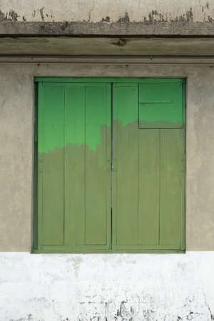 unevenness: Old Closed Green Wooden Window Shutters