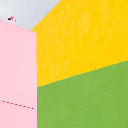 small town life: Colorful house iin abstract under blue sky Stock Photo