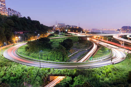 Highway interchange in night with cars moving light, Taipei, Taiwan, Asia. photo