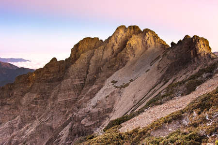 Mountain scenery of golden peak in morning, the famous Yushan Southern Peak in Taiwan, Asia. Stock Photo
