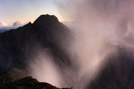 Dramatic mountain scenery with clouds over the famous Yushan Main Peak, Taiwan, Asia. photo