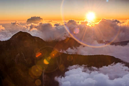 Sunset scenery with famous Yushan West Peak under sunlight and lens flare in Taiwan, Asia.