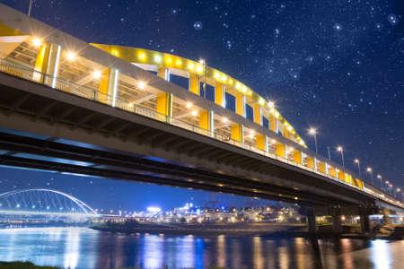 Night scene of bridge under stars in Taipei, Taiwan, Asia. Photo manipulation. photo