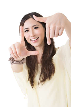 Attractive smiling woman using her hands to create a border around her face, close up portrait on white background. photo
