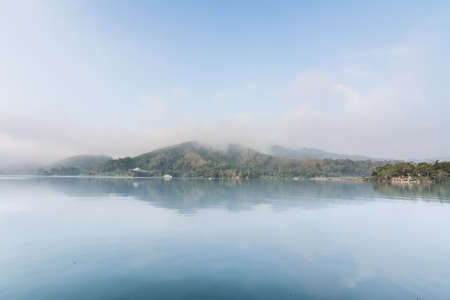 quiet scenery: Landscape of famous Sun Moon Lake in the morning with mist in Taiwan, Asia.