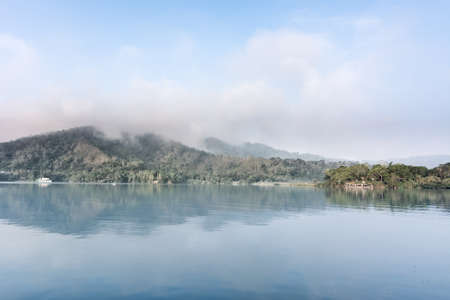 Landscape of famous Sun Moon Lake in the morning with mist in Taiwan, Asia. photo