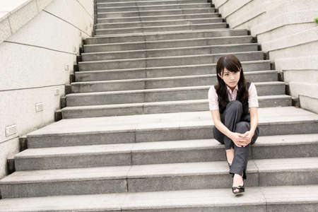 disappoint: Sad business woman feel worried and stressed in outside of modern city. Stock Photo