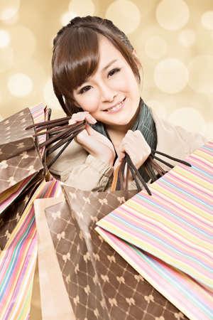 Happy smiling shopping girl, closeup portrait. photo
