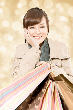 Happy smiling shopping girl, closeup portrait. photo