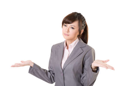 Helpless young business woman shrugs her shoulders on white background.