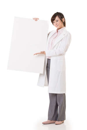 Asian doctor woman holding blank board, full length portrait isolated on white background. photo