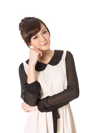 De Aziatische schoonheid draagt ??een de lentekleding, close-upportret op witte achtergrond wordt geïsoleerd die. Stockfoto