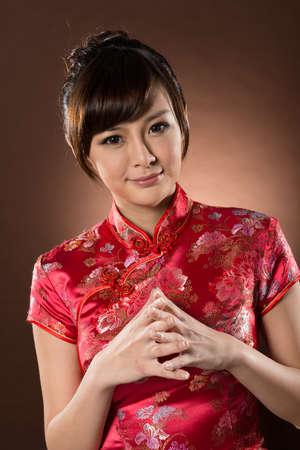 chipao: Attractive Chinese woman dress traditional cheongsam at New Year, closeup studio shot.