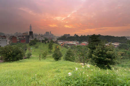 metropolitan: Sunset cityscape with dramatic clouds over the skyline and park in Taipei, Taiwan, Asia. Stock Photo
