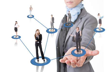 Business network conception, Asian business people use mobile phone to communicate to each other at a woman's hand. Stock Photo - 24702497