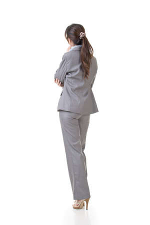 consider: One business executive lowered head and contemplate, full length portrait isolated on white background.