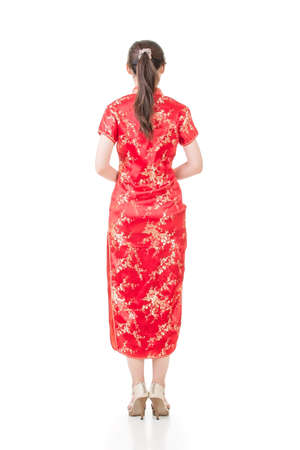 qipao: Chinese woman dress traditional cheongsam on white background, rear view. Stock Photo
