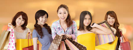 Happy smiling Asian shopping women on white background. photo