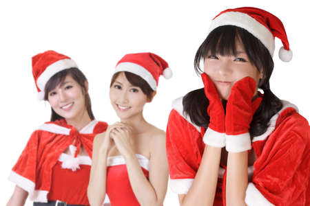 Happy smiling Asian Christmas girls, closeup portrait of three young women. photo