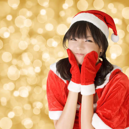 Happy adorable Christmas girl of Asian, closeup portrait. photo