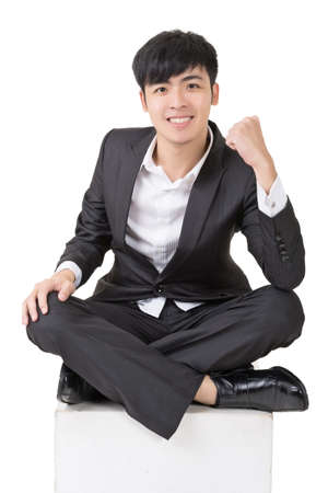 Asian business man feel free or exciting, full length portrait squat and isolated on white background. photo