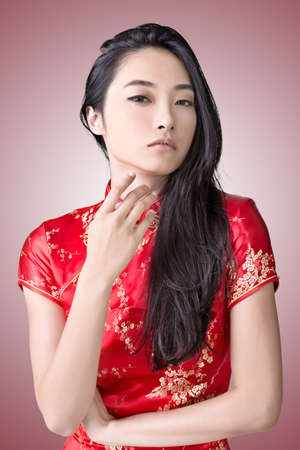 Sexy Chinese woman dress traditional cheongsam, closeup portrait. photo