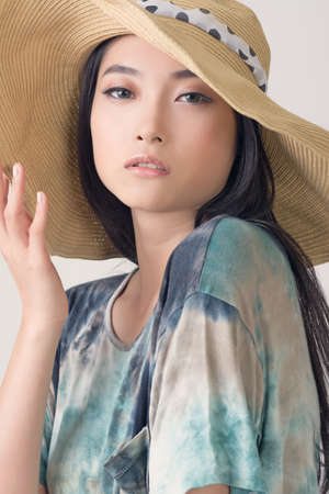 Glamour of Asian beauty with hat, closeup portrait. photo