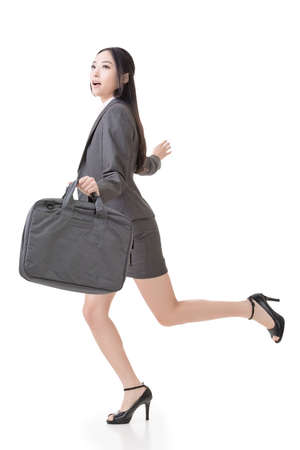 Asian businesswoman run and hold a briefcase, side view full length portrait isolated on white background. photo