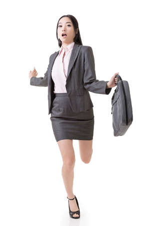 Asian businesswoman run and hold a briefcase, full length portrait isolated on white background. photo