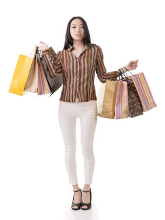 Asian shopping woman holding bags, full length portrait isolated on white. photo