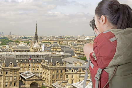 Young backpacker travel and take picture in Paris with famous Eiffel Tower. photo
