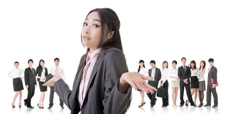 Attractive Asian business woman give you a helpless sign and stand in front of her team. photo